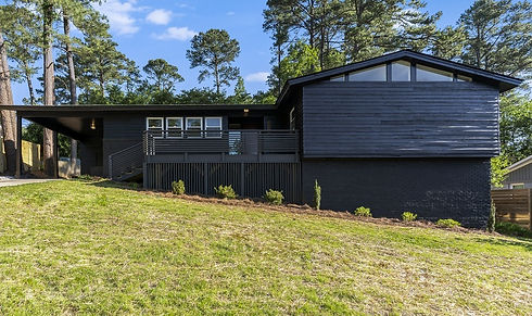 mid-century-home-renovation-black-exterior-raleigh-brecken-oaks-listing_edited_edited.jpg