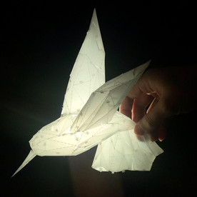 Paper folded bird
