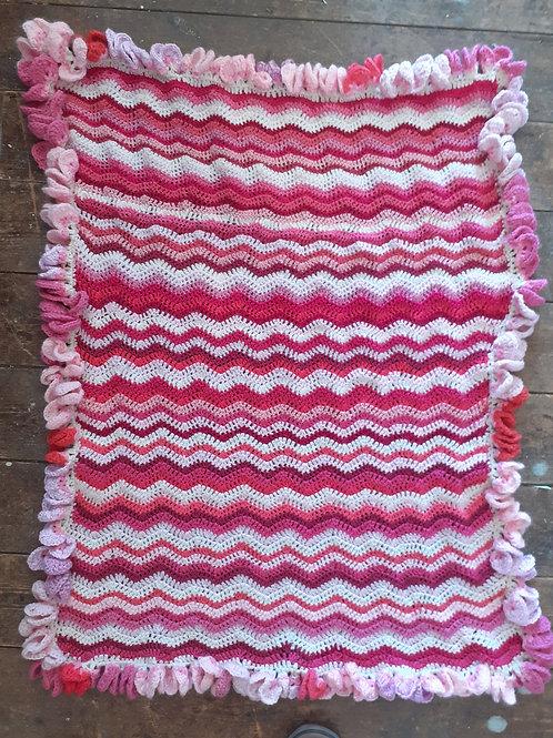 Hand crocheted baby blanket in sweet pea pinks