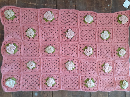 Hand crocheted baby blanket in antique pink and cream