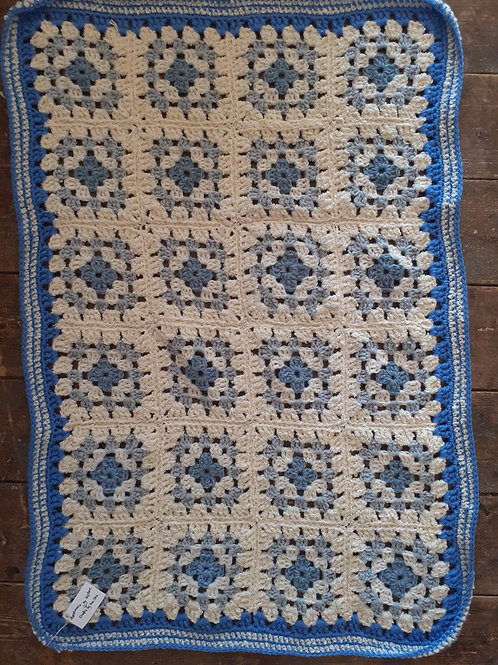 Hand crocheted baby blanket in sky blue and cloud