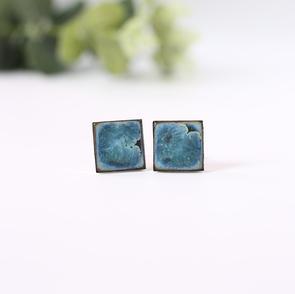 Erika albrecht Ceramics handmade, black porcelain cufflinks, light blue.JPG