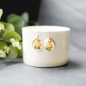 Erika-Abrecht-Ceramics-yellowrose-handpainted-handmade-oval-earrings.jpg