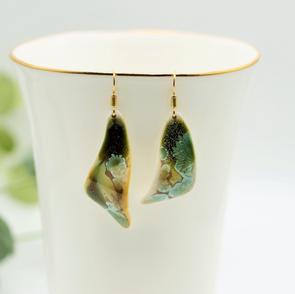 Gold dreen earrings.JPG