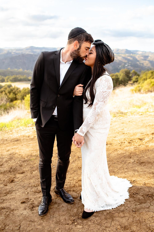 jewish bride and groom kiss on topanga canyon state park trail