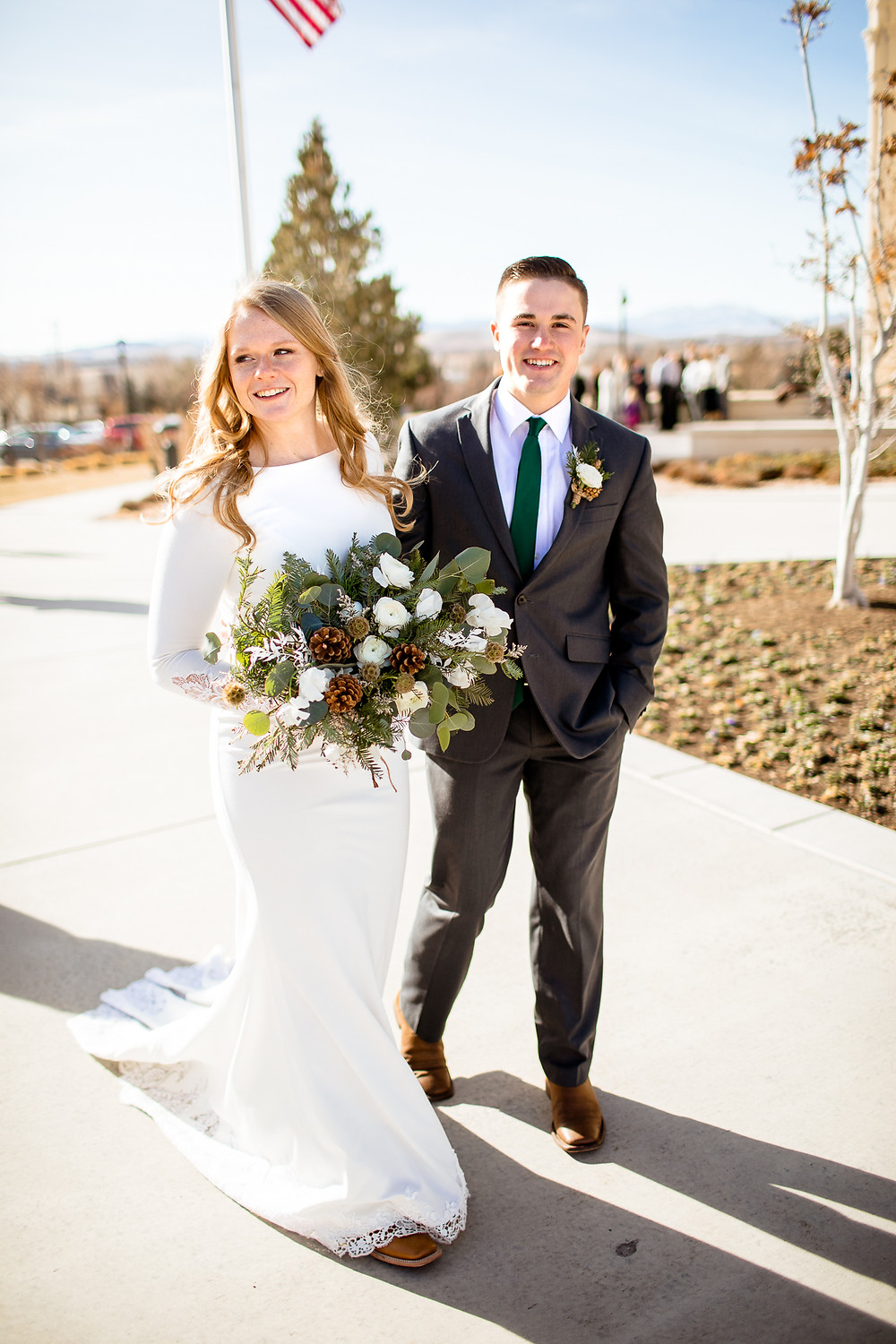 bride and groom walking on payson utah temple grounds
