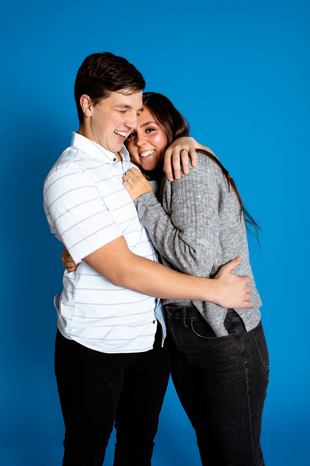 blue studio backdrop for couples photography session