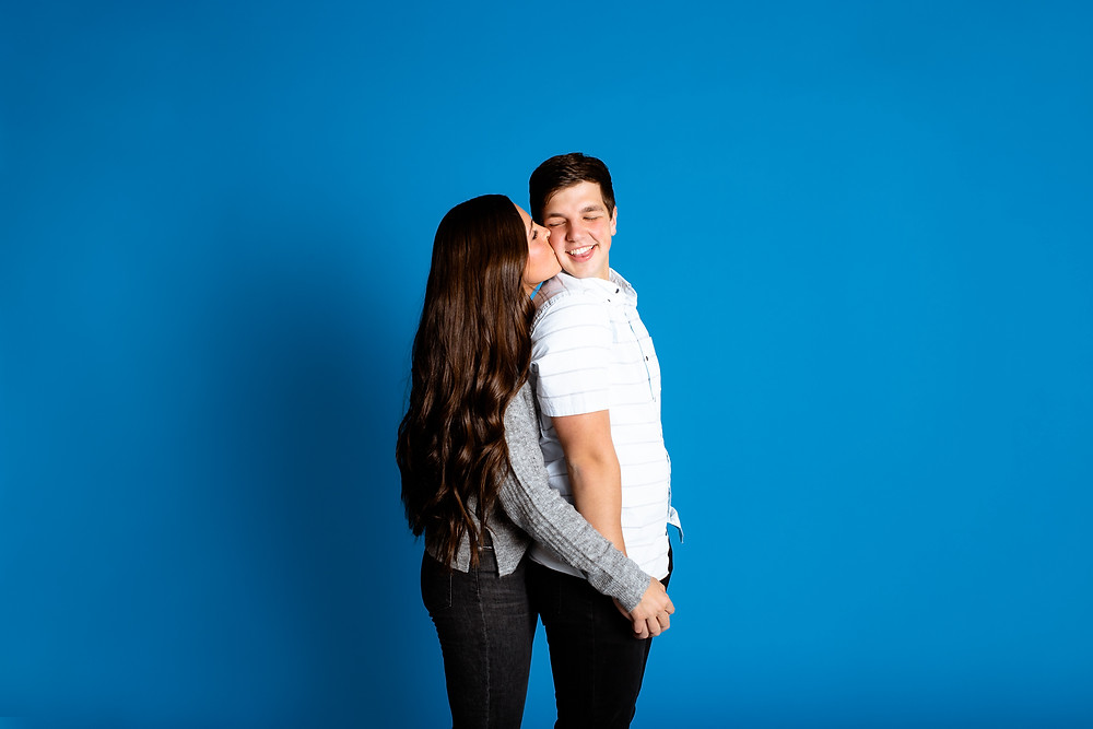 bright blue background for couples photos