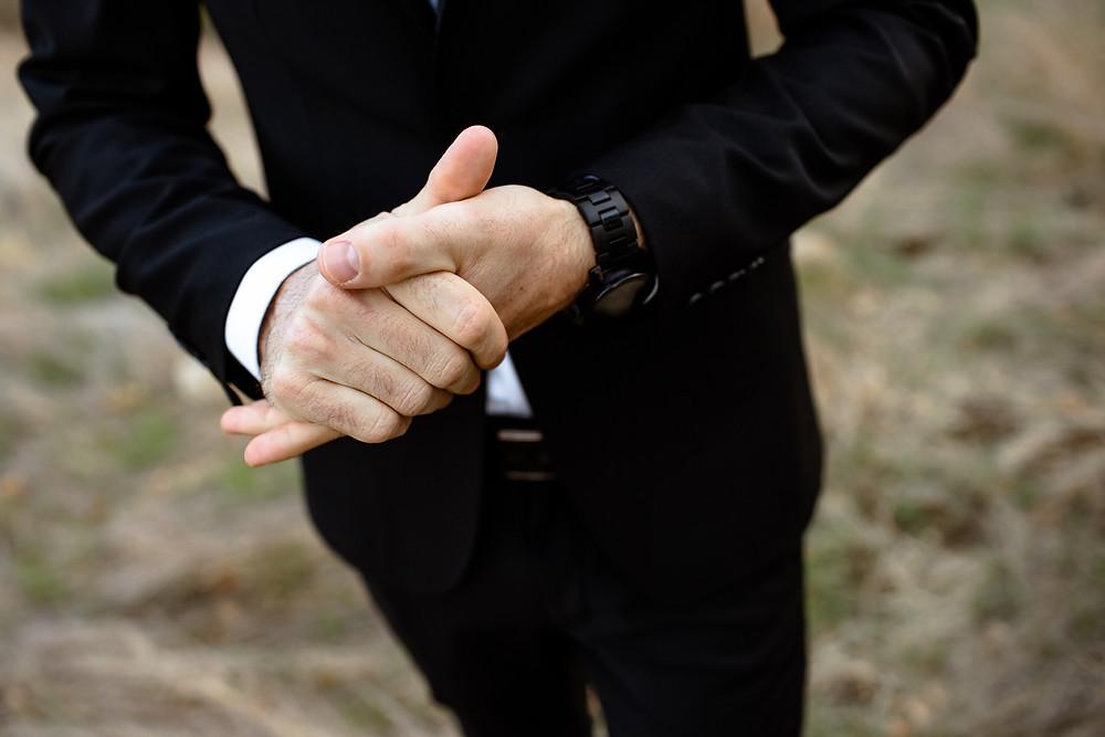 groom's clasped hands
