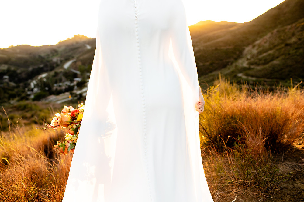 Wedding Cape | Rust Orange Groom's Suit | Pronovias Wedding Dress and Cape | Katie B Creative | Malibu Elopement Photography