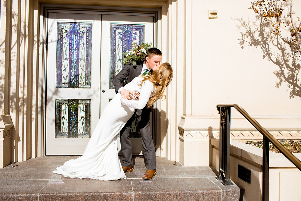bride and groom kiss after sealing in payson, utah temple