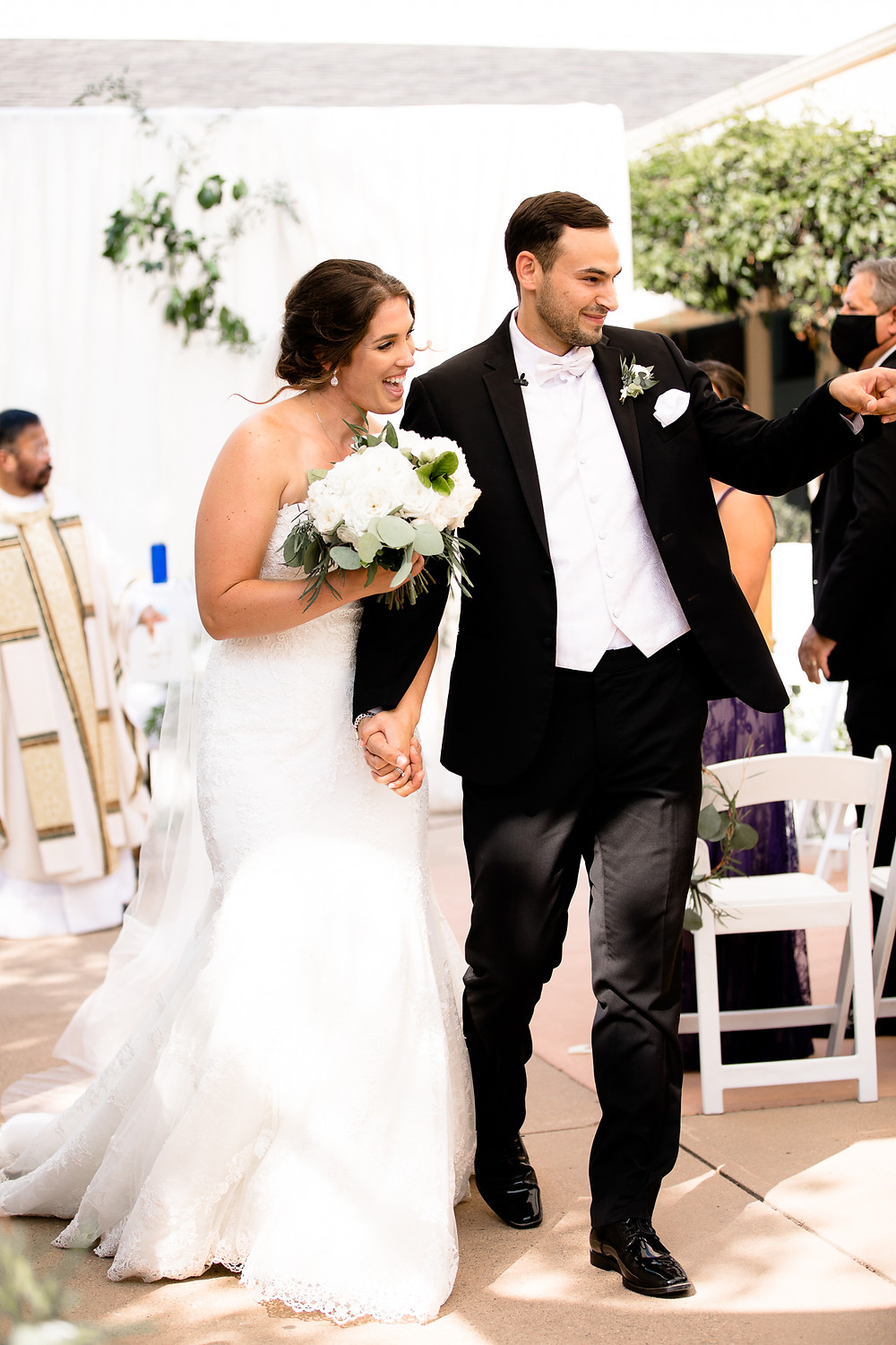 bride and groom walking down the aisle smiling after their wedding ceremony