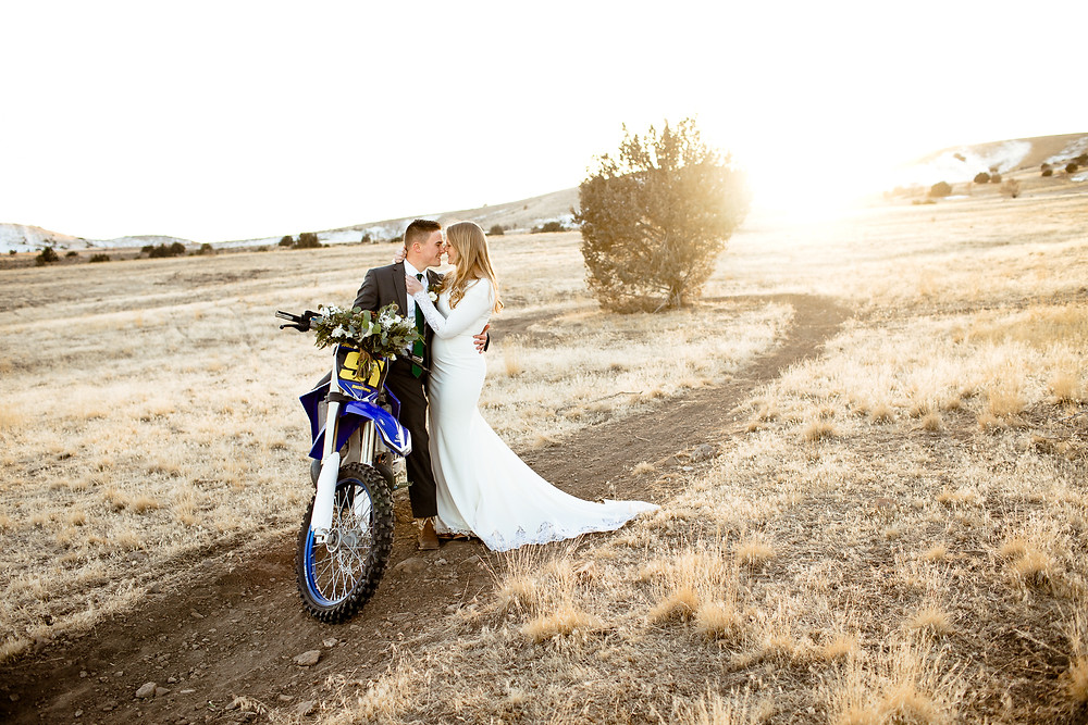 bride and groom in Payson, Utah with dirtbike and bouquet