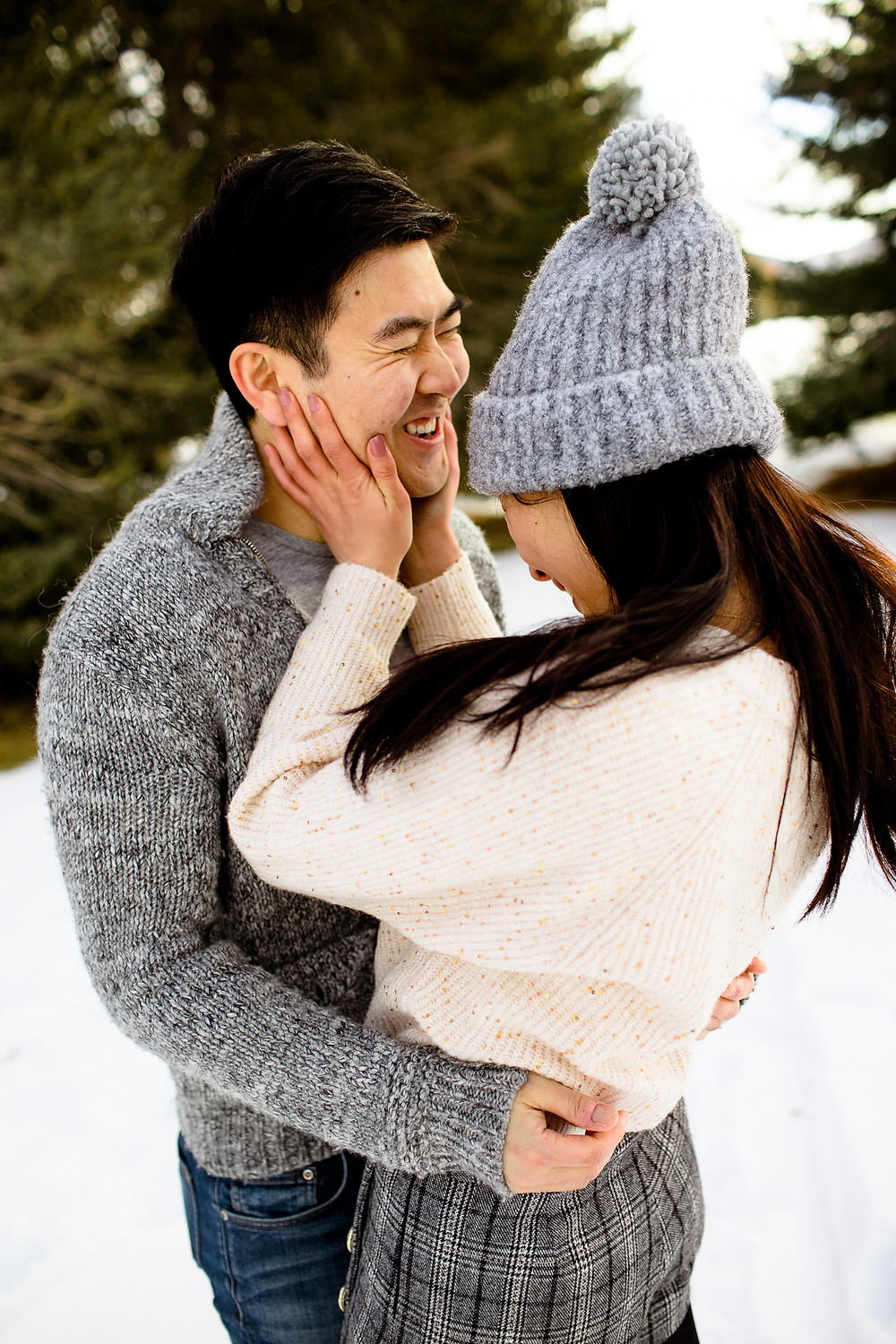 woman holding on to man's smiling face