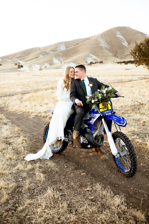 bride sitting on the back of groom's dirtbike in payson, utah