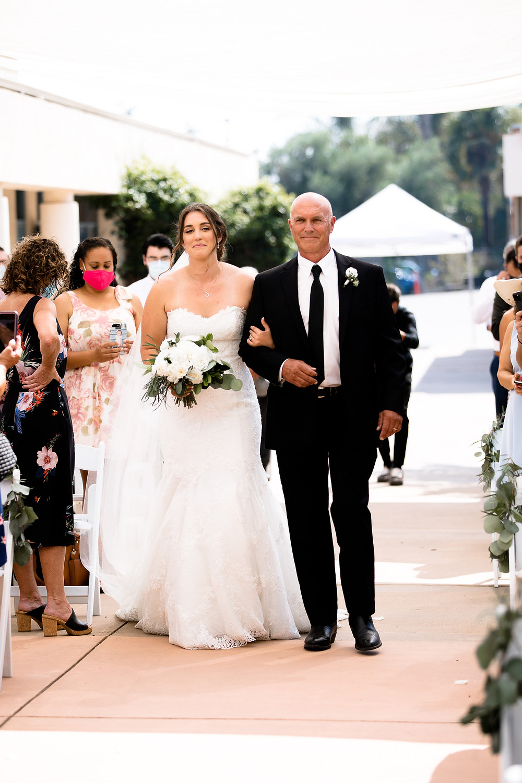 covid bride walking down the aisle