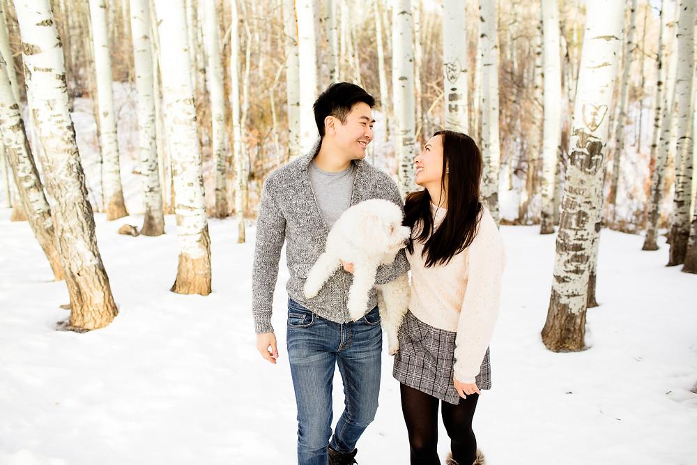 cute couple walking in snowy utah park