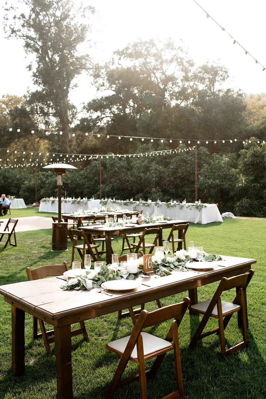 green and white floral tablescape at backyard reception in santa barbara california