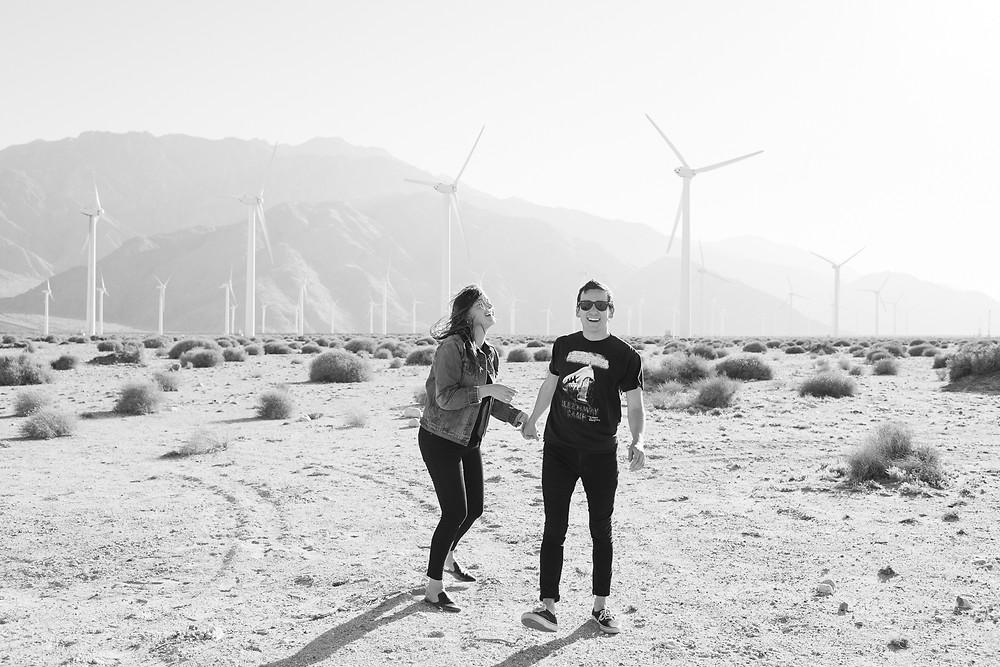 black and white photo of couple walking in California desert