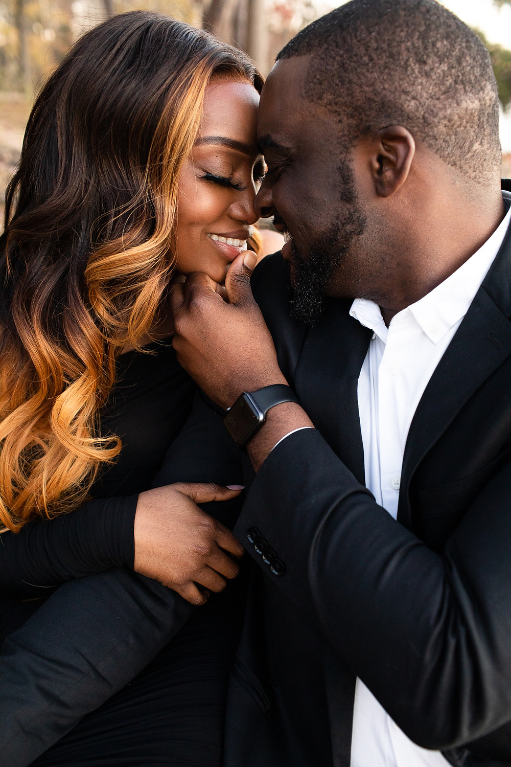 beautiful couple touching foreheads and smiling