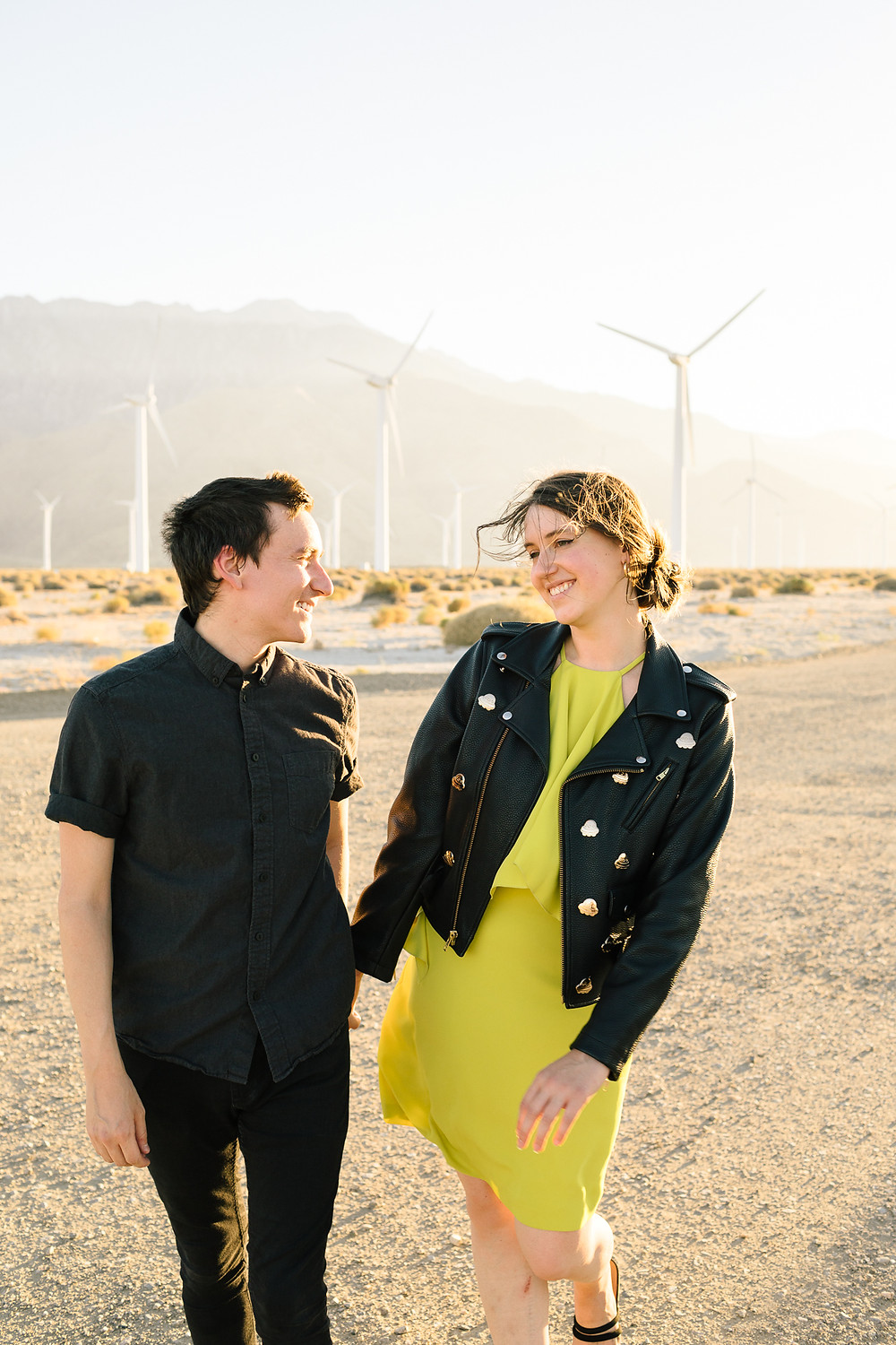 couple in dressy clothes walking in palm springs desert