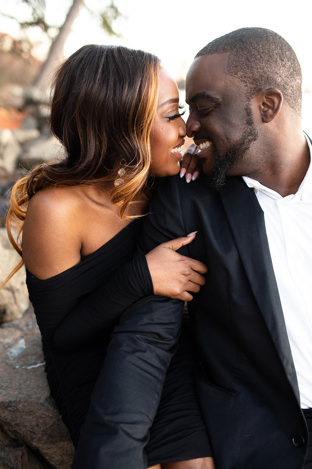 black couple laughing and nuzzling noses