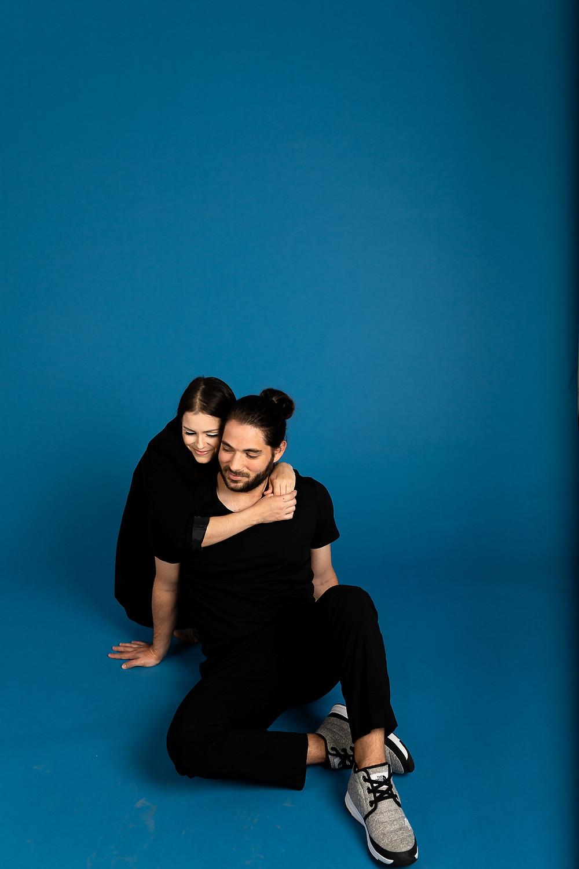 couple cuddling on the floor of blue los angeles studio