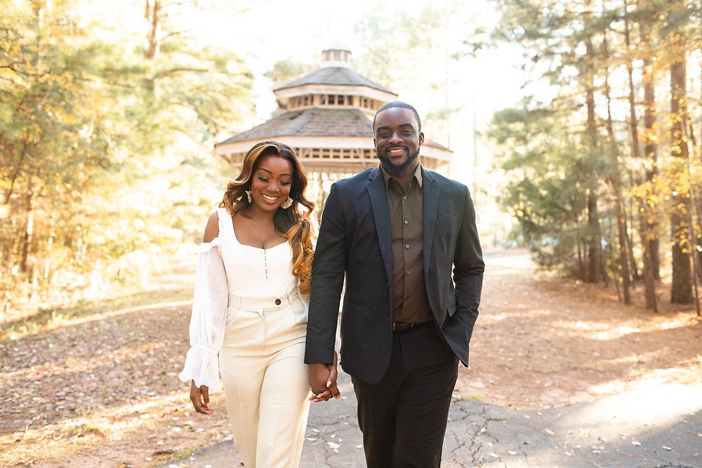 black couple walking and smiling at jetton park