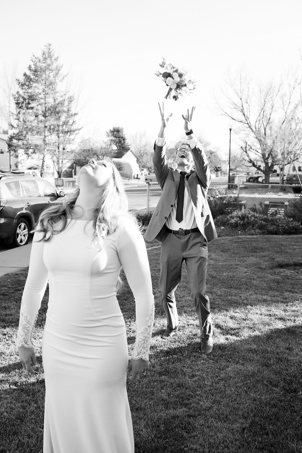 bride tossing her bouquet at her brother