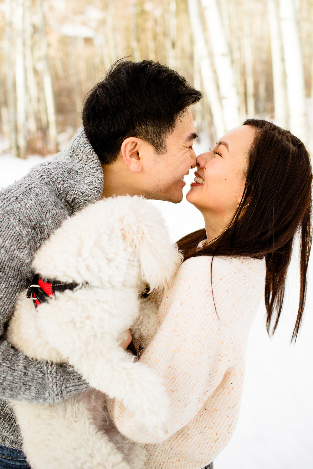 man and woman nuzzling in park city utah