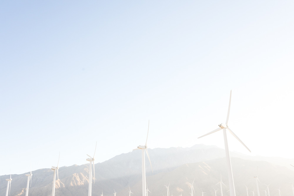 palm springs windmills and mountain range at golden hour