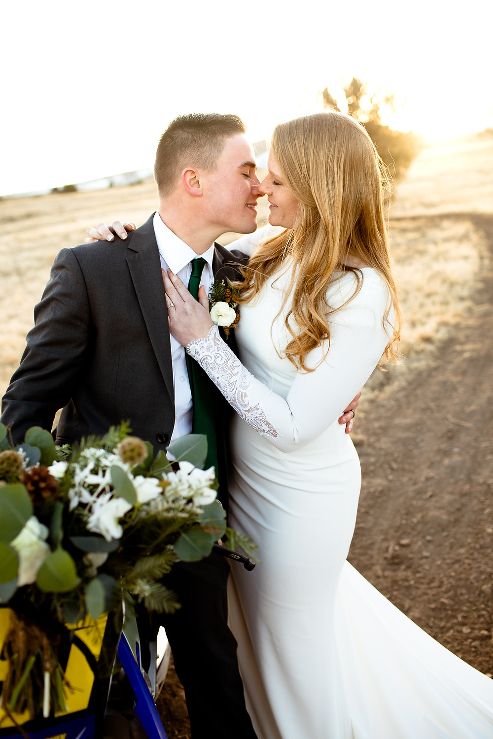 bride and groom nuzzle noses