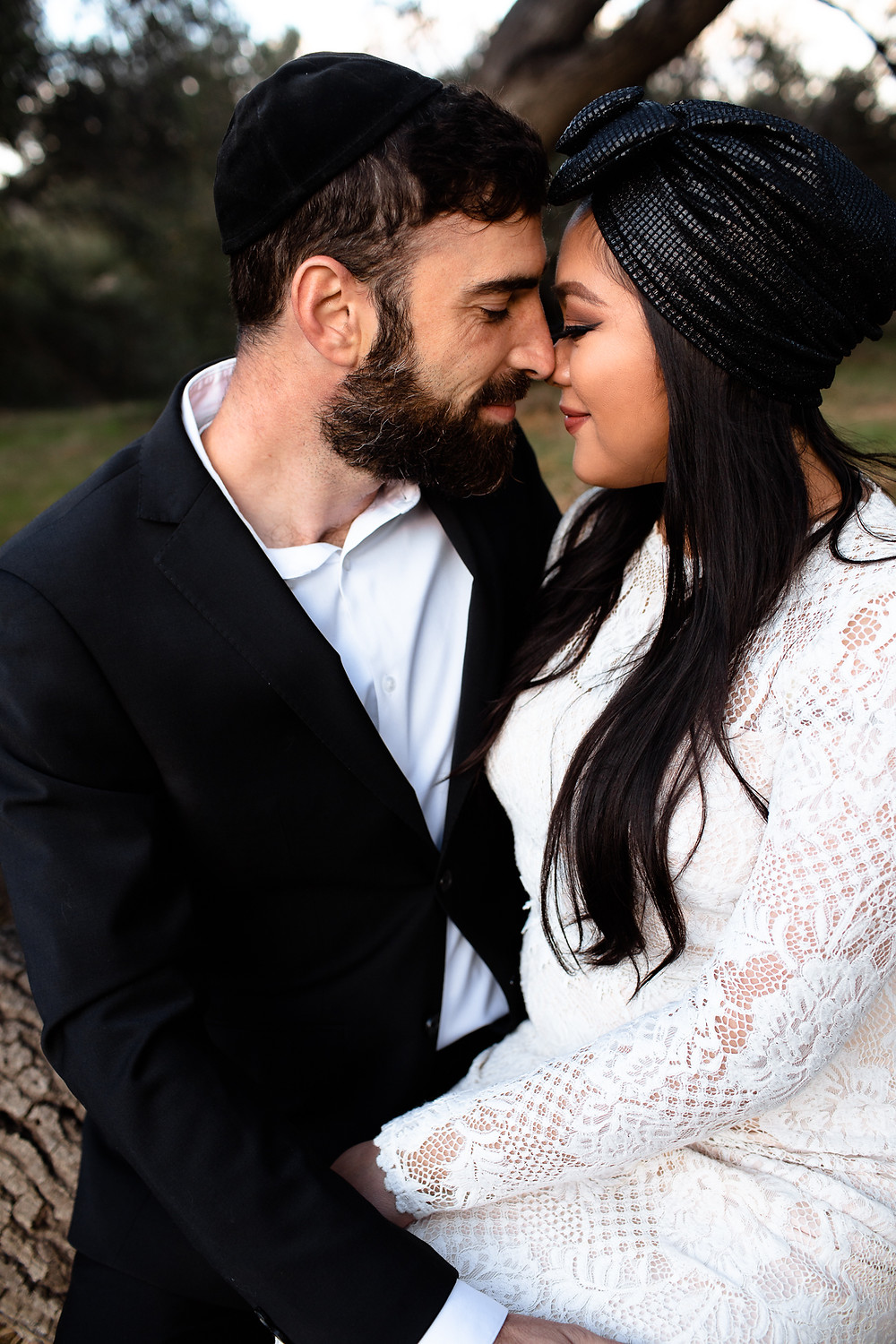 jewish bride and groom nuzzling noses
