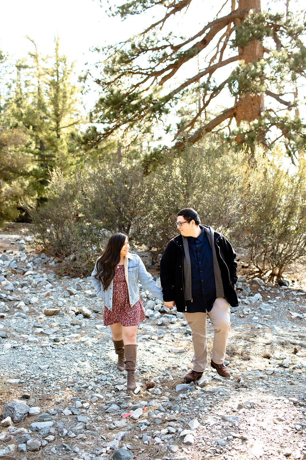Man and woman walking in pine trees at Mount Baldy, California