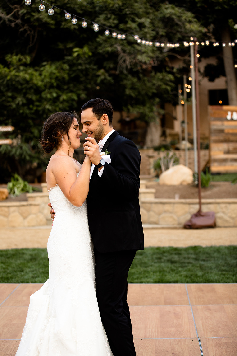 bride and groom's first dance at their backyard reception in santa barbara