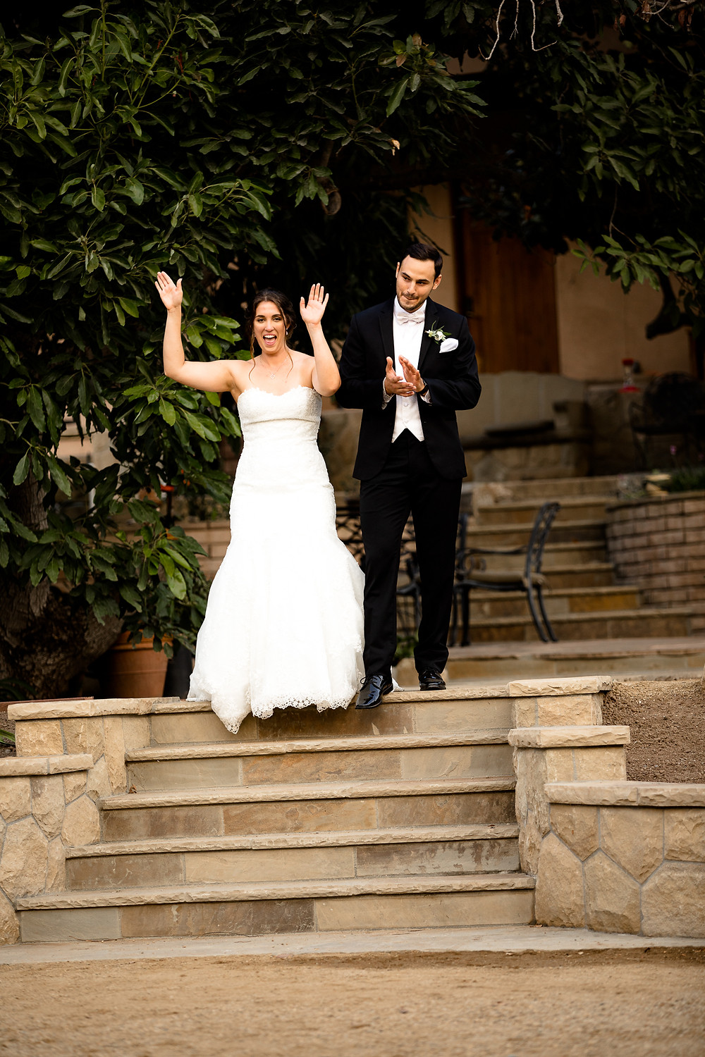 bride and groom's grand entrance to their reception