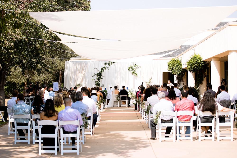 outdoor catholic wedding ceremony under a tent