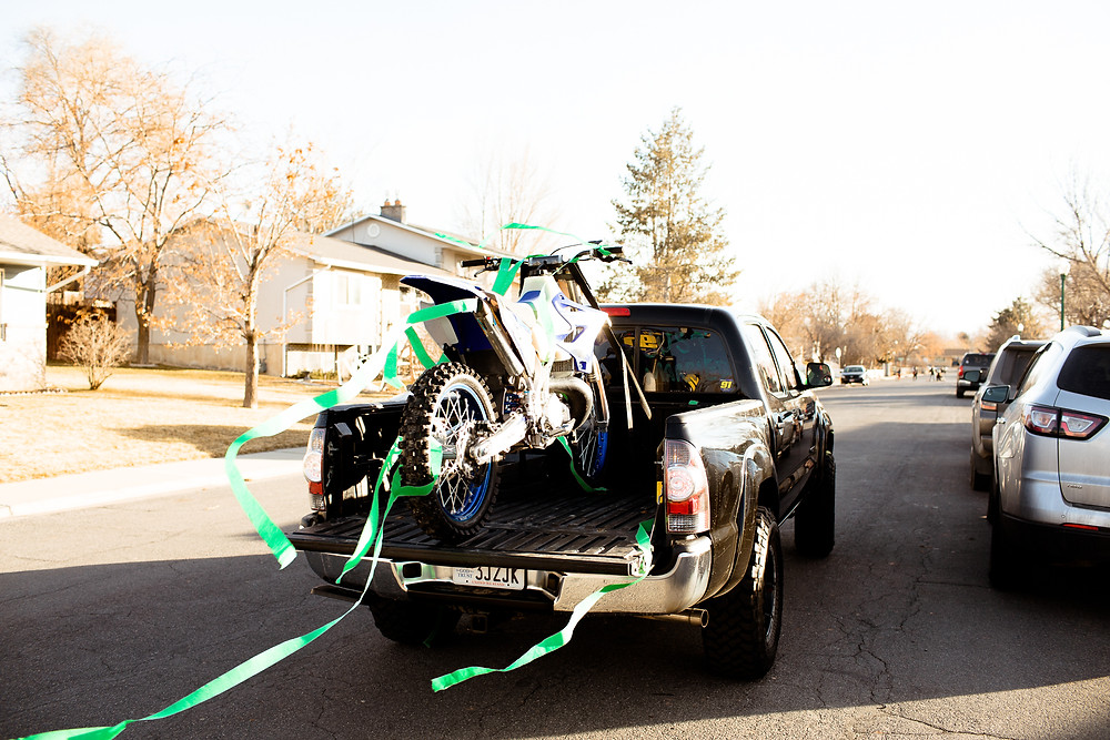 getaway truck with dirtbike and streamers on the back