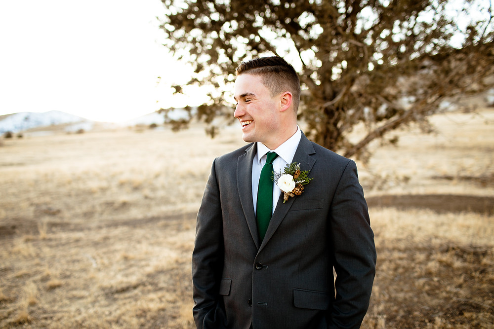 groom laughing in the payson, utah foothills
