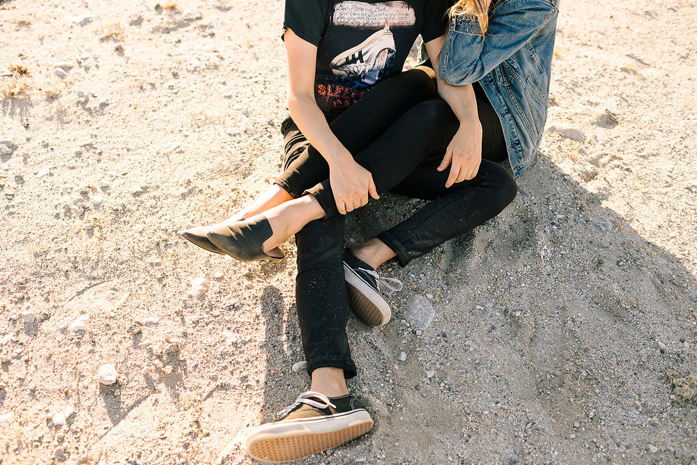 couple sitting together in the desert
