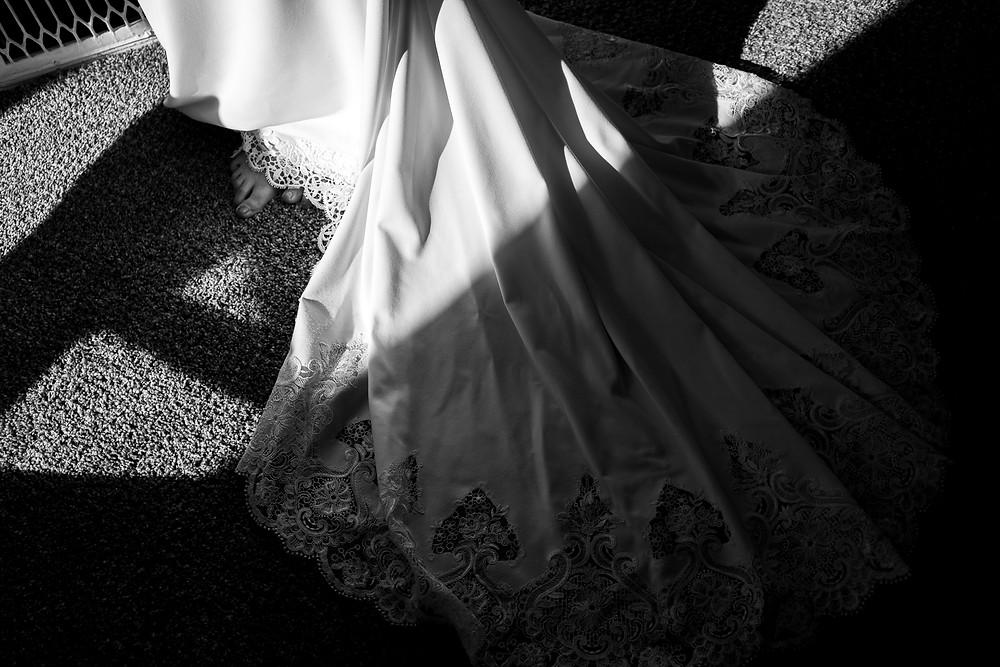 black and white harsh shadows across wedding dress train