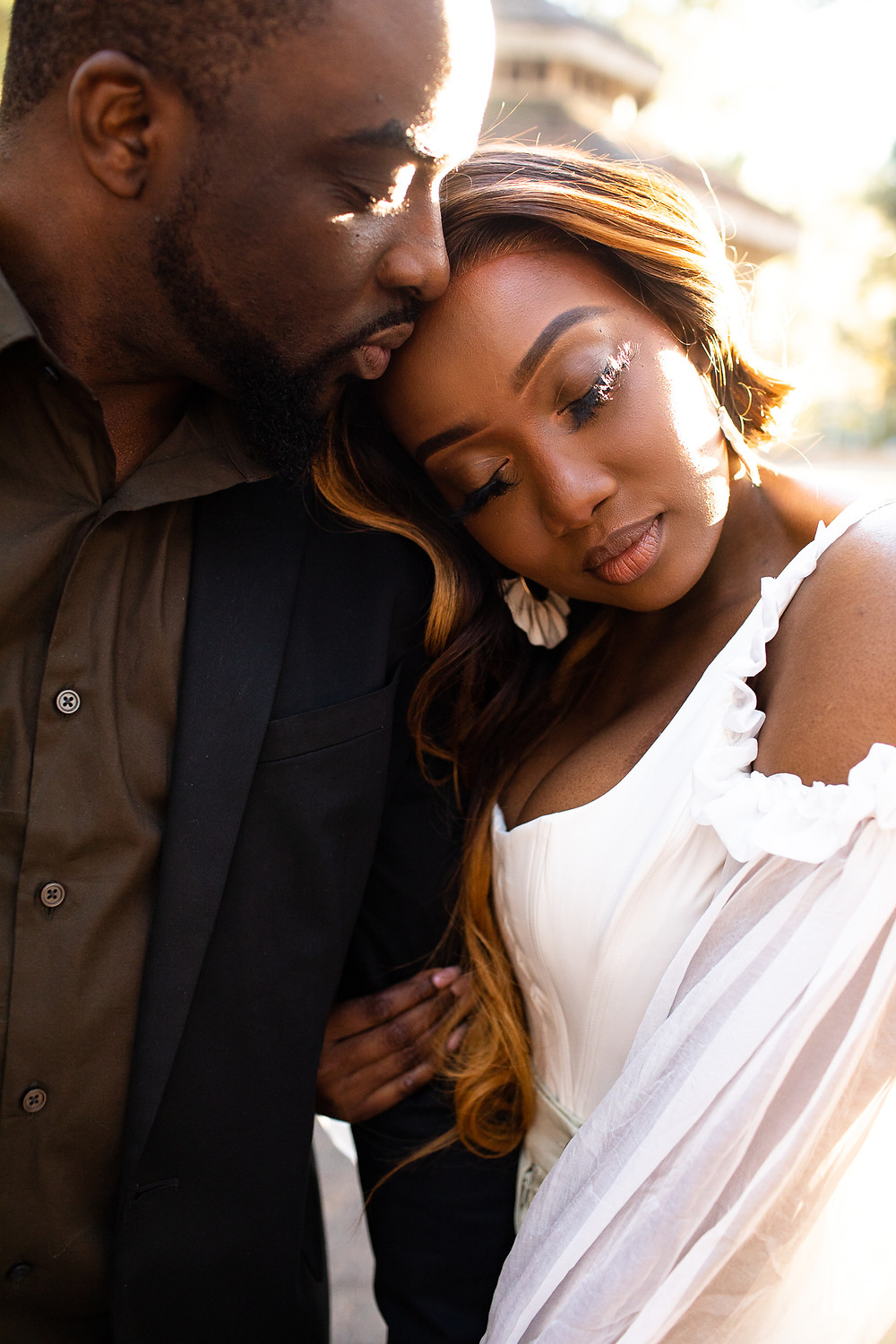 beautiful black couple cuddling with their eyes closed in charlotte, north carolina