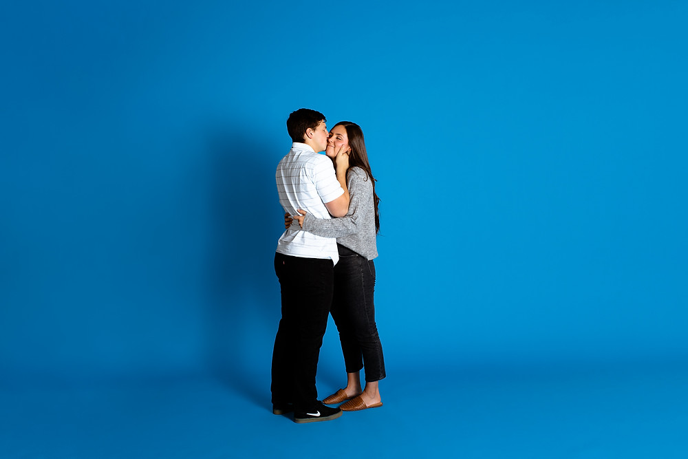 blue artificially lit studio couples session