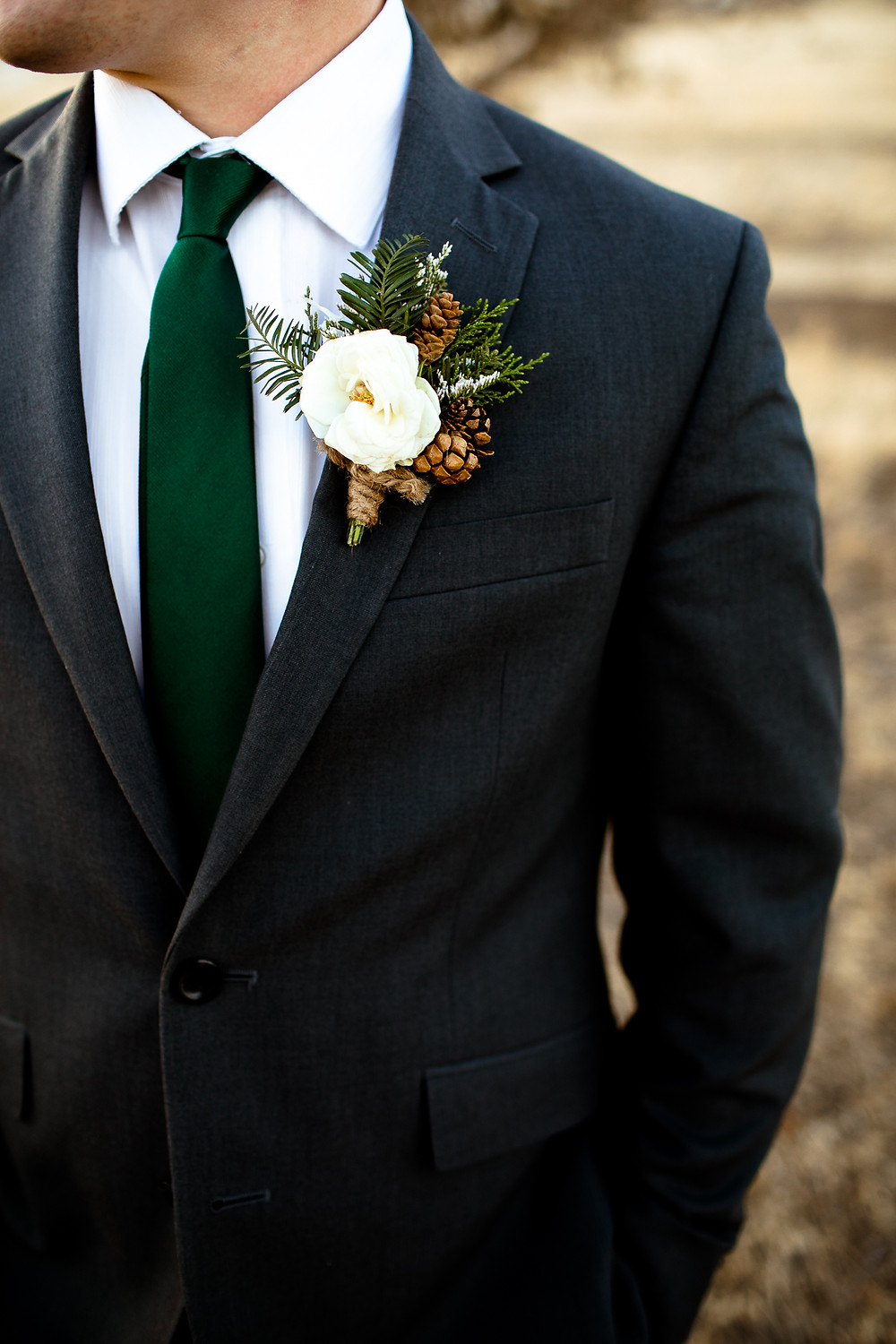 close up of groom's boutonniere by lennox floral