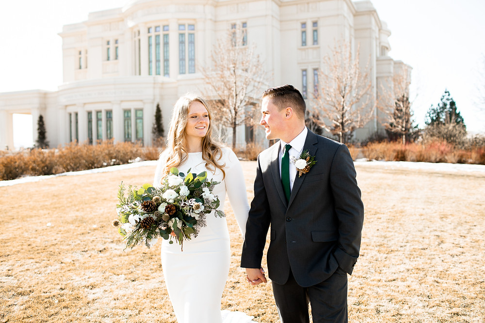 couple walking in front of payson, utah temple