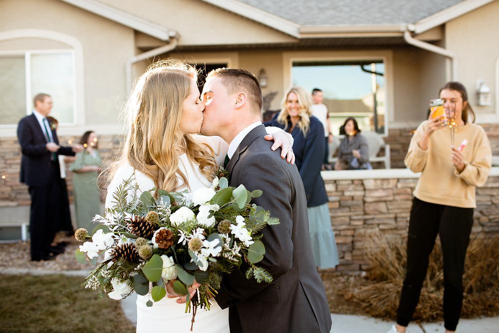 bride and groom kiss after sparkler exit