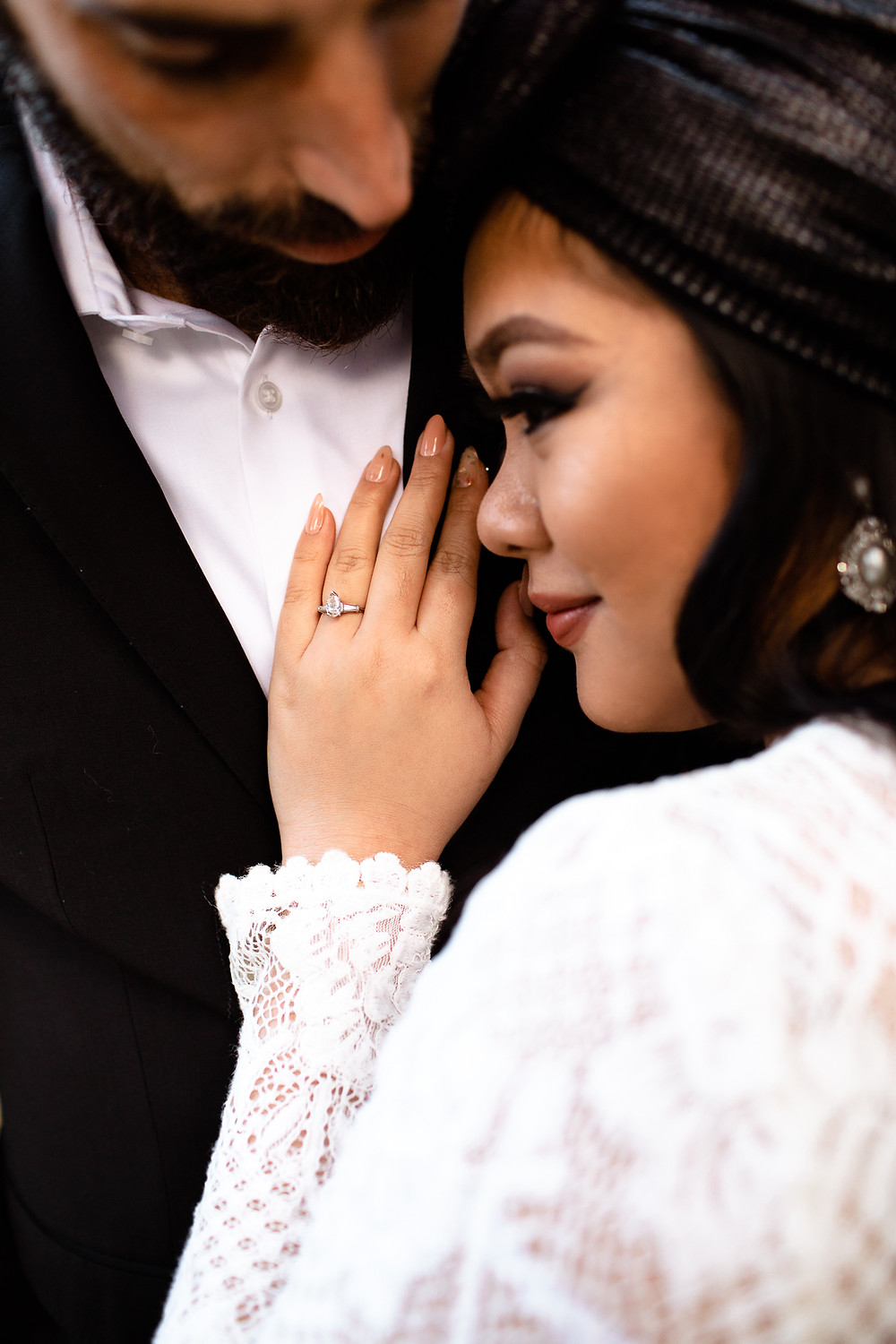 bride resting her hand on groom's chest