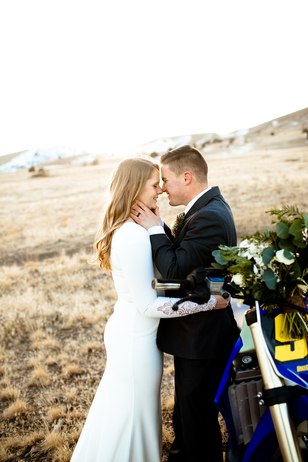 bride and groom smiling at each other in the payson utah foothills in winter