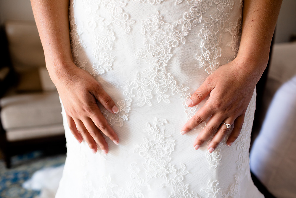 close up detail of lace on wedding dress