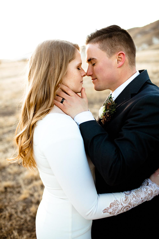 groom tenderly holding bride's face